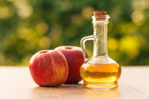 Apple cider Vinegar can be used to remove flat moles